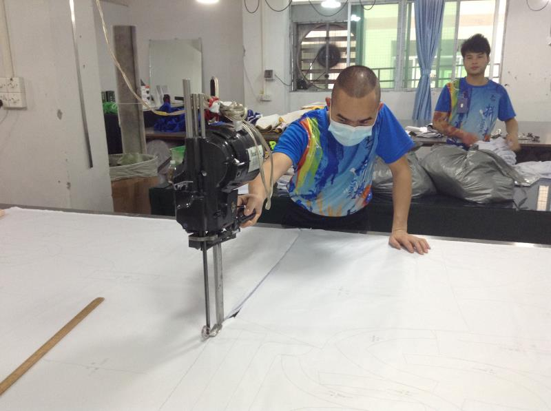 Workers are cutting fabrics