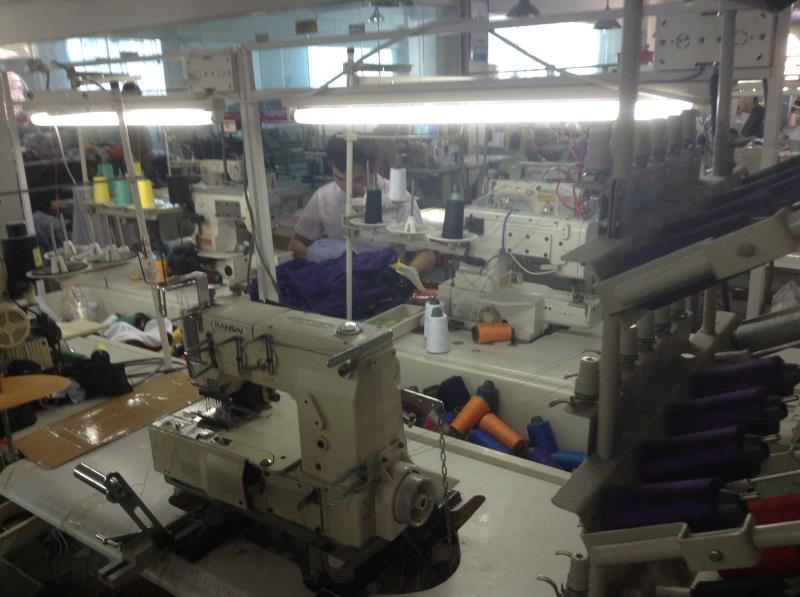 Workers from Guangzhou garment factories are busy sewing different parts of clothes together