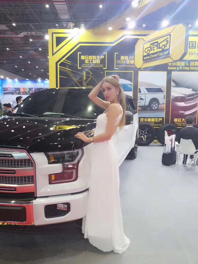 Models pose beside cars on display at Automechanika Shanghai 2017-1